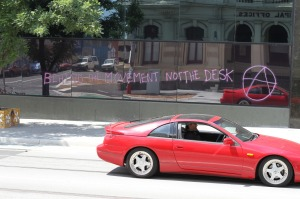 graffiti: 'BEHIND THE MOVEMENT NOT THE DESK'